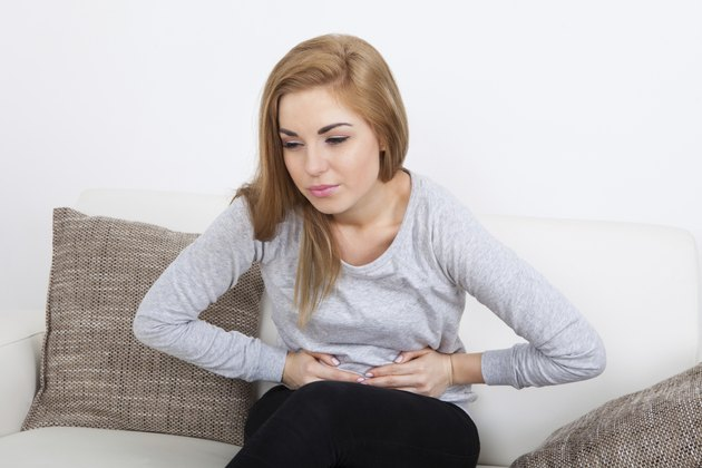 Young Woman Suffering From Stomach Ache