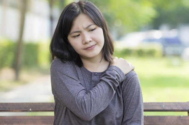 Woman: Shoulder Pain at Park