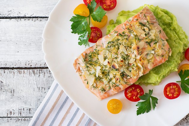 Baked salmon with cheese and almond crust and garnished