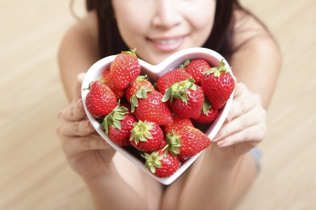 Woman smiling with strawberry