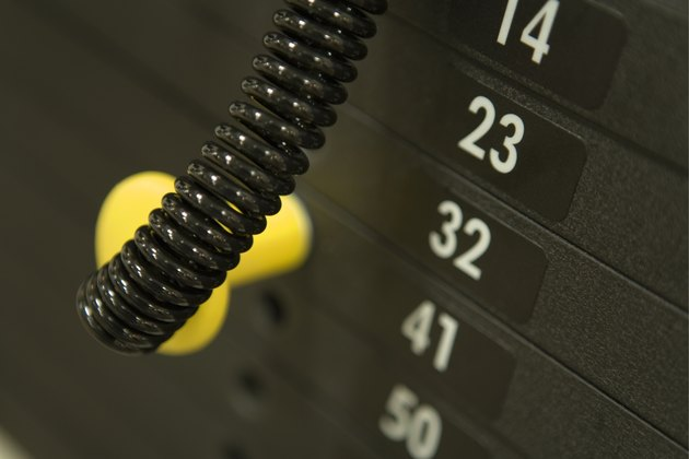 Weights on an exercise machine in gym, high angle view, close up, differential focus
