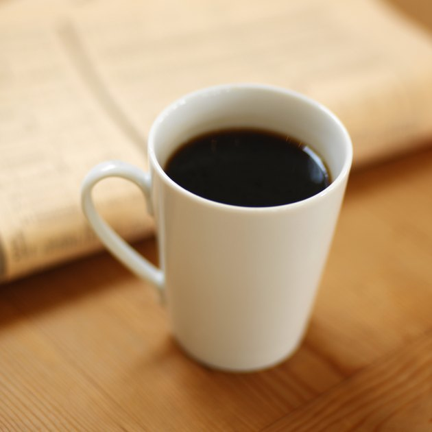 elevated view of a mug of black coffee