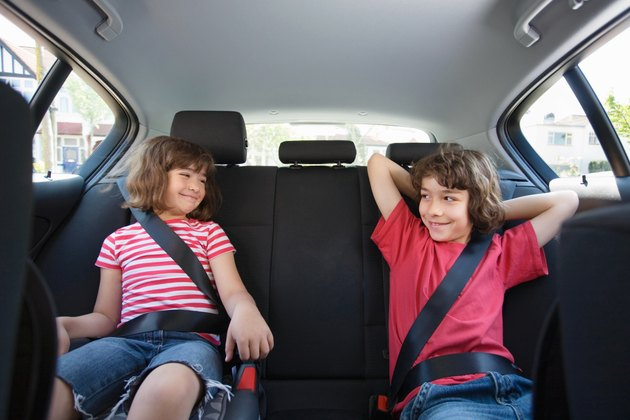 Children sat in a car