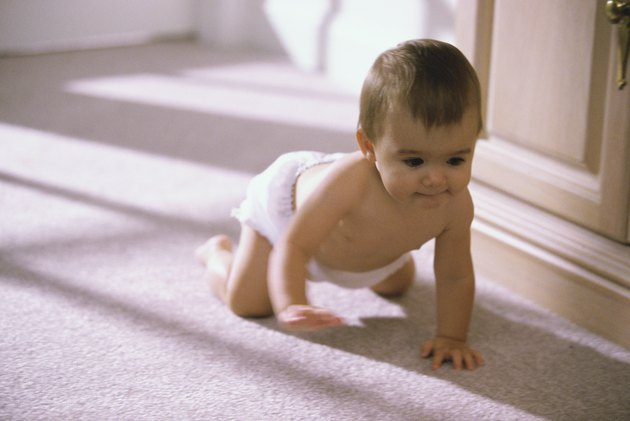 Baby boy crawling on the floor