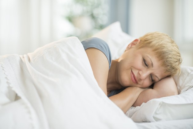 Woman Smiling While Sleeping In Bed