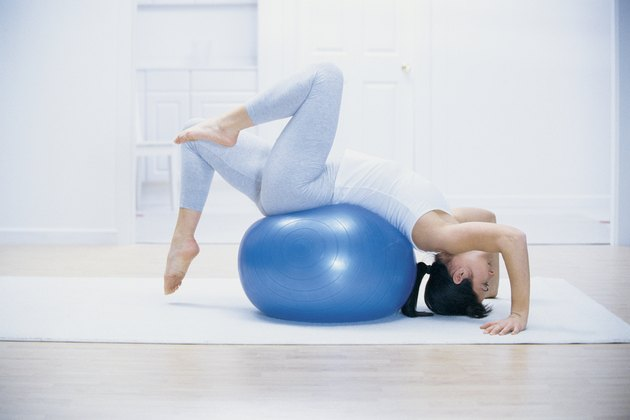 Woman stretching on yoga ball