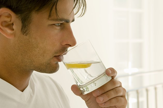 Man drinking water with lemon