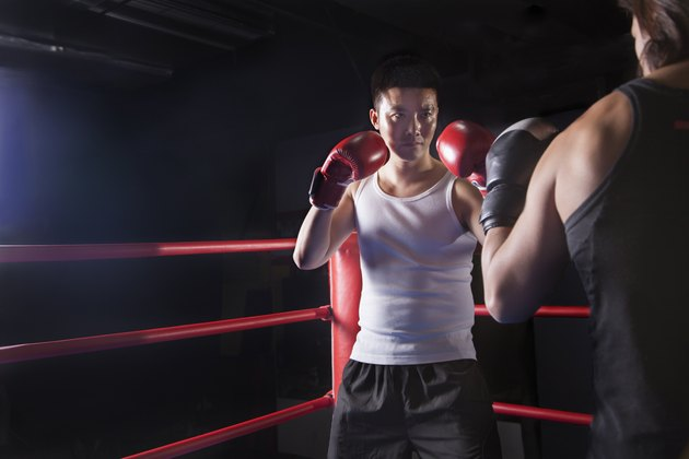 Over the shoulder view of two male boxers getting ready to box in the boxing ring in Beijing, China