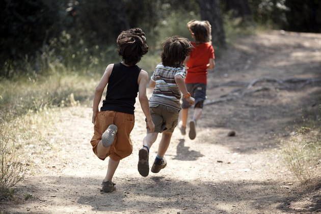boys running on trail