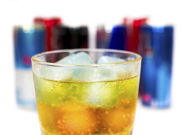 glass with ice and energy drinks on the background