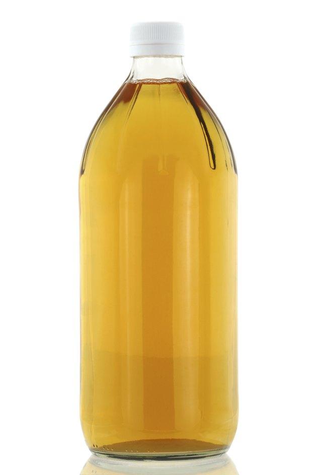 Apple Cider Vinegar isolated on white
