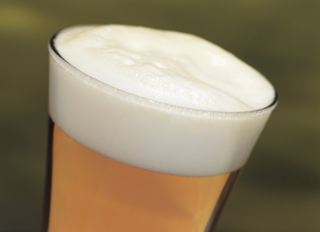 close-up of a head of beer in a glass