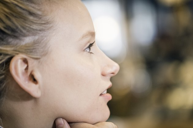 Close-up of thoughtful young woman in cafe