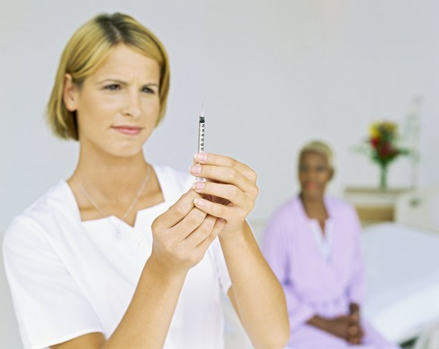 close-up of a female nurse holding a syringe