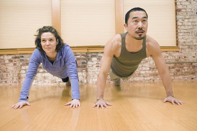 Young couple doing push-ups