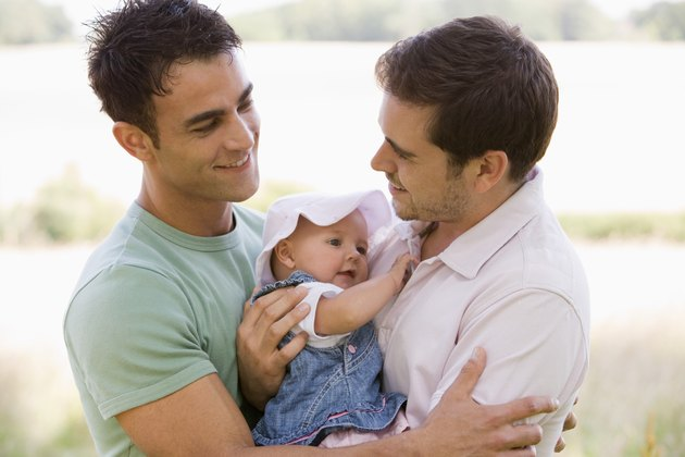 Smiling men with baby