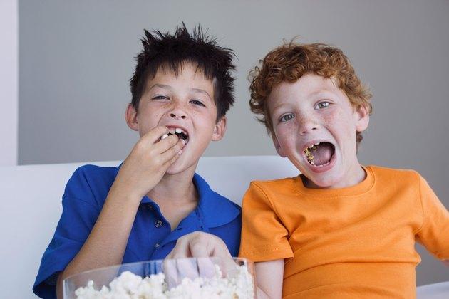 Boys sharing popcorn