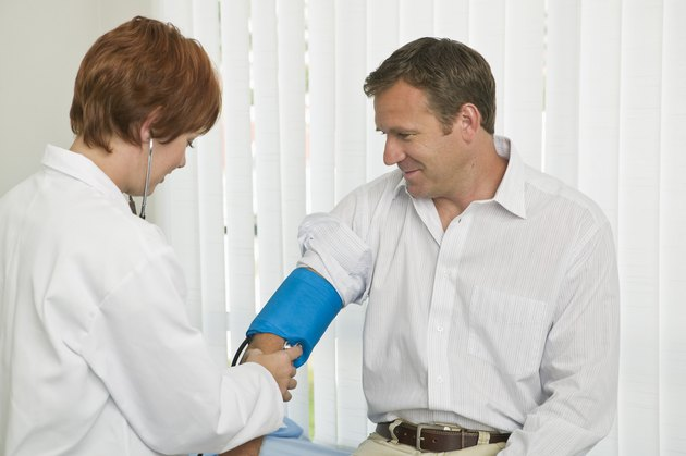 Doctor examining blood pressure on patient