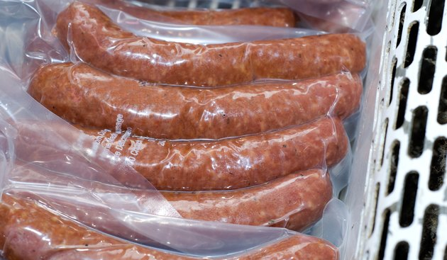 Packaged sausages on display in deli