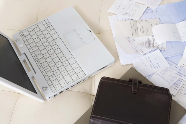 Bills and receipts by laptop