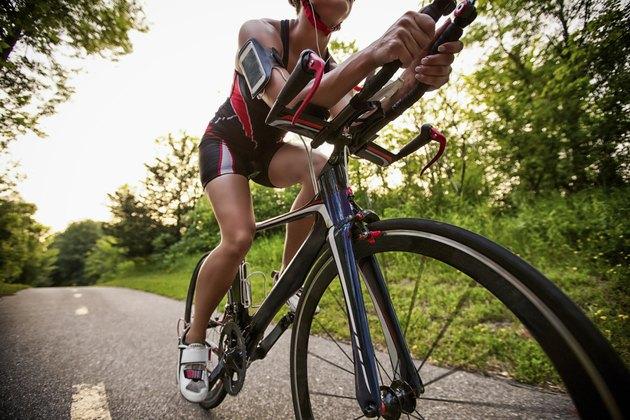 Cyclist listening music on smart phone