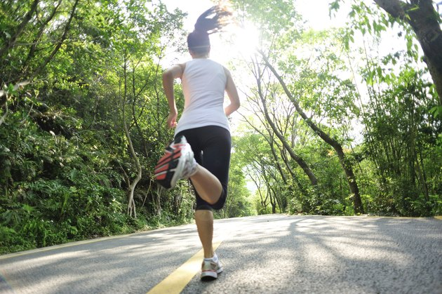 healthy lifestyle fitness sports woman  running at mountain forest road