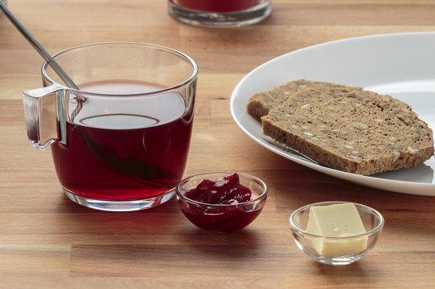 Strawberry tea, strawberry jam, butter and rye bread