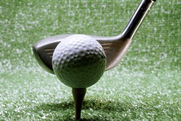 Close-up of a golf club next to a golf ball