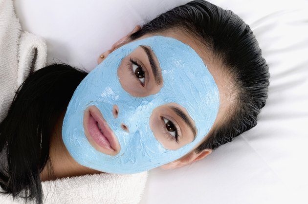 Portrait of a young woman with a facial mask