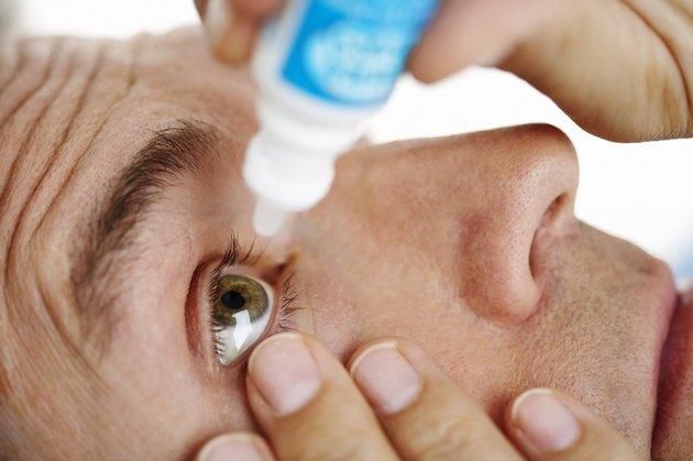 Man Applying Eye Drops