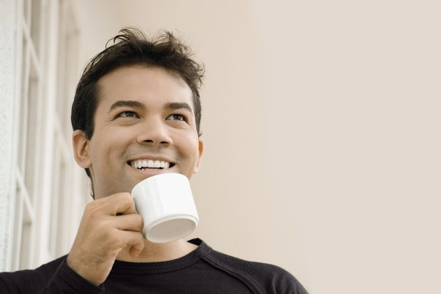 Close-up of a businessman holding a cup of tea