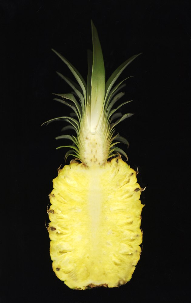Pineapple (Ananas comosus) cut in half