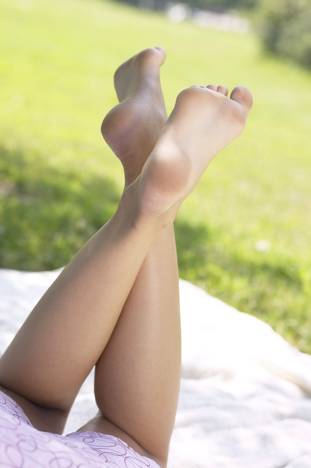 Legs of woman lounging in park