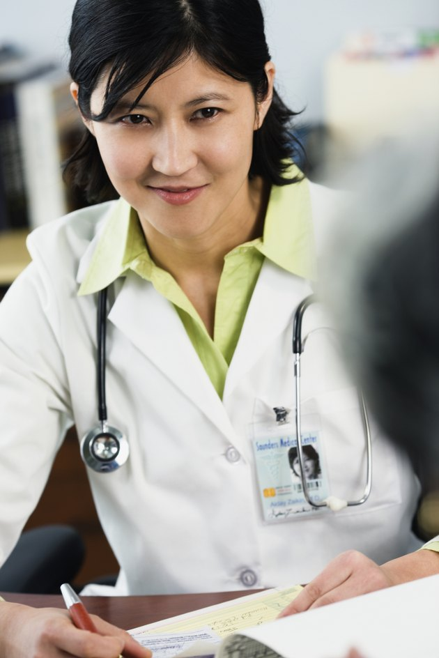 Kazakh female doctor listening to patient