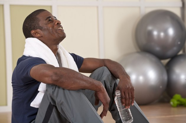 man taking rest after workout