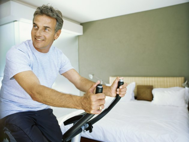 Senior man exercising with a exercising bicycle