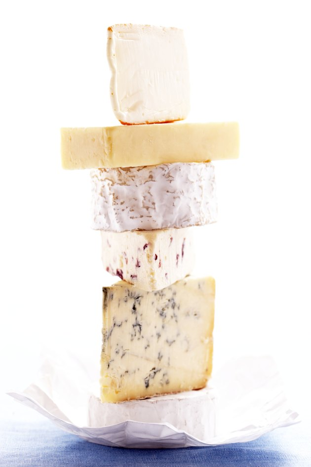 Stack of assorted of cheeses, close-up