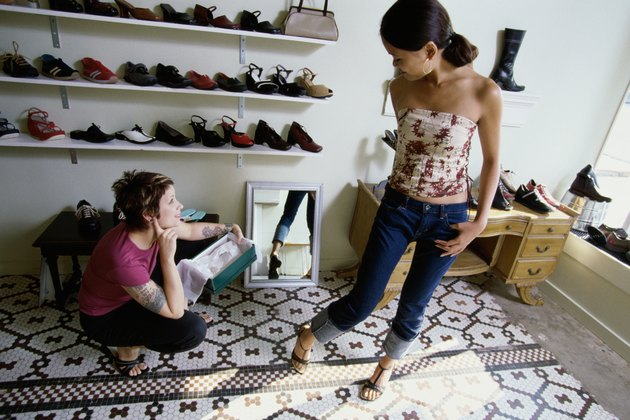 Young woman trying on sandals in a shoe store