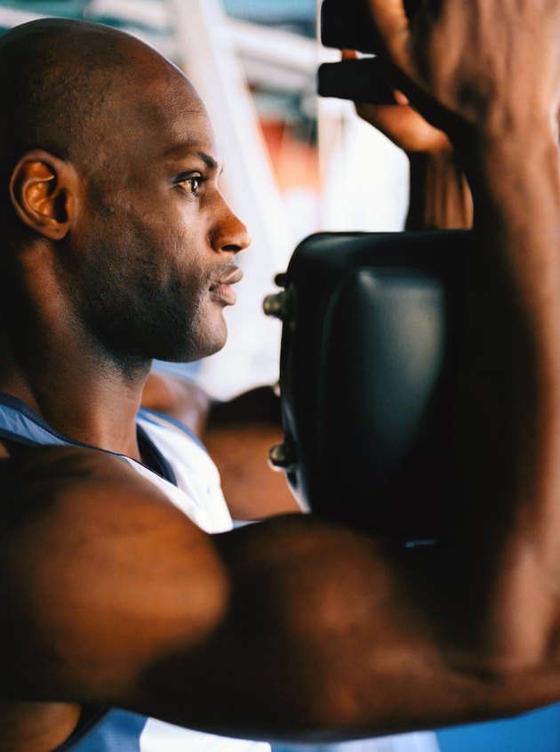 side profile close-up of a man exercising in a gym