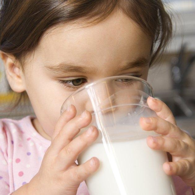 Girl drinking milk.