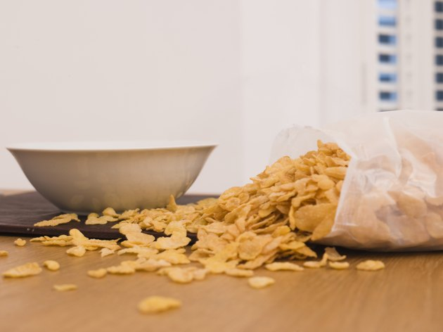 Cereal spilled near bowl on table