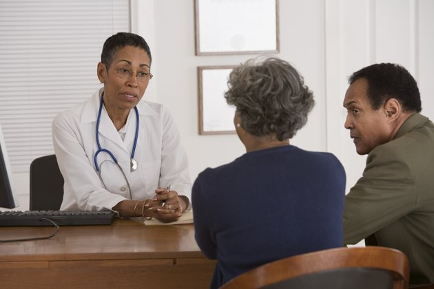 Doctor talking with a couple