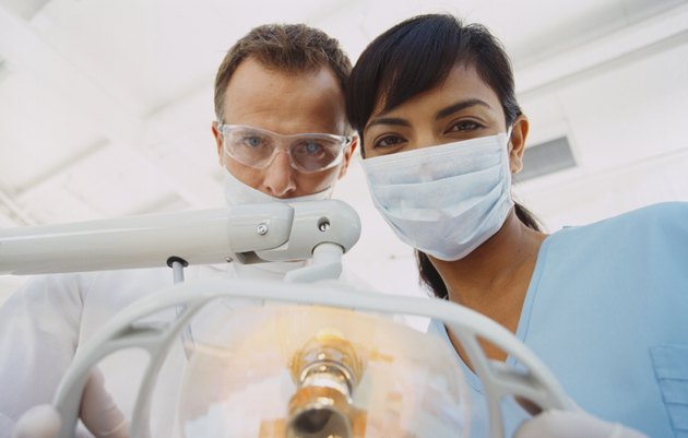 Low angle view of a male dentist and a female nurse wearing full scrubs