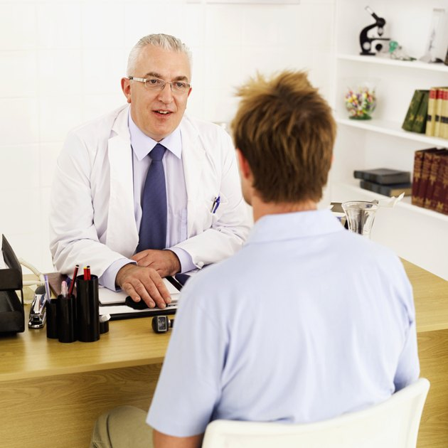 doctor sitting at desk talking to patient
