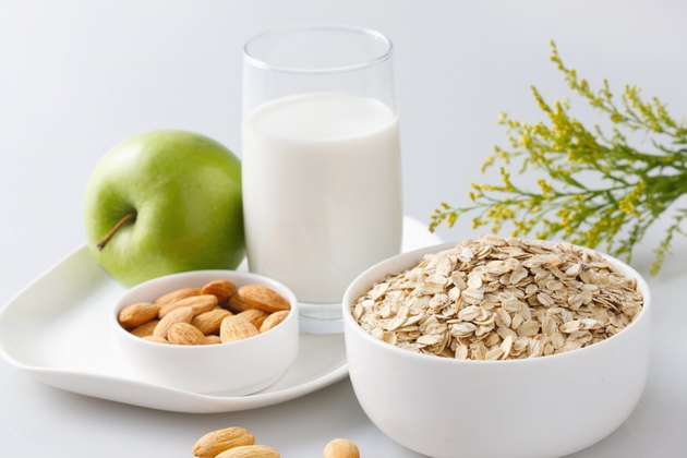 """Oatmeal with almonds,apple and glass of milk"""