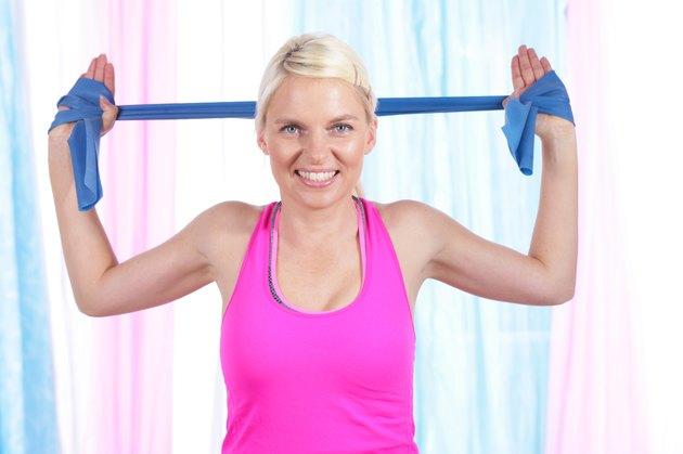 Happy woman doing exercises