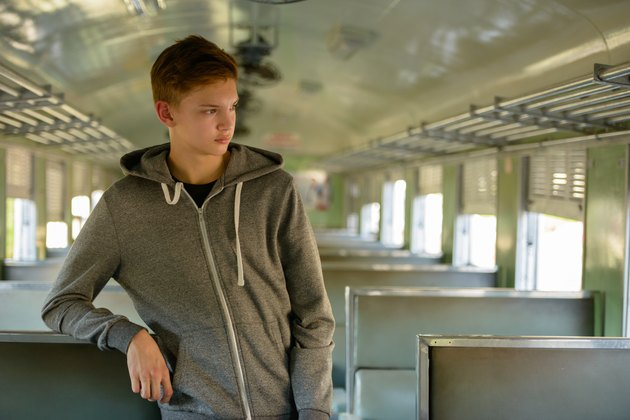 Teenager boy traveling with train