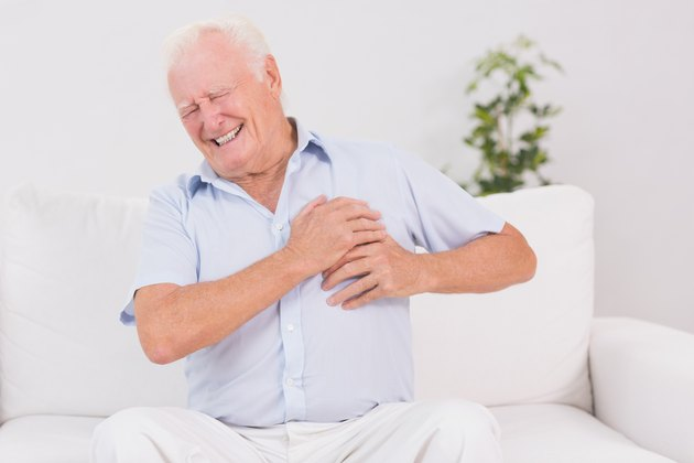 Old man suffering with heart pain
