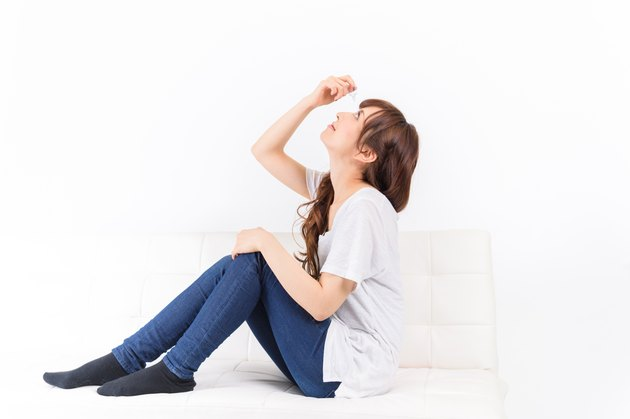 japanese young woman put in the eye drops