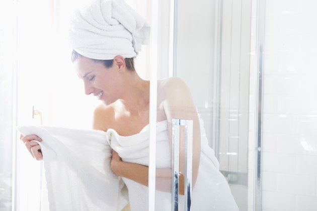 Woman getting out of the shower